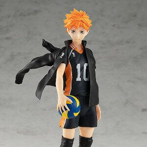 Volleyball player Shoyo holding a volleyball with his jacket on shoulder